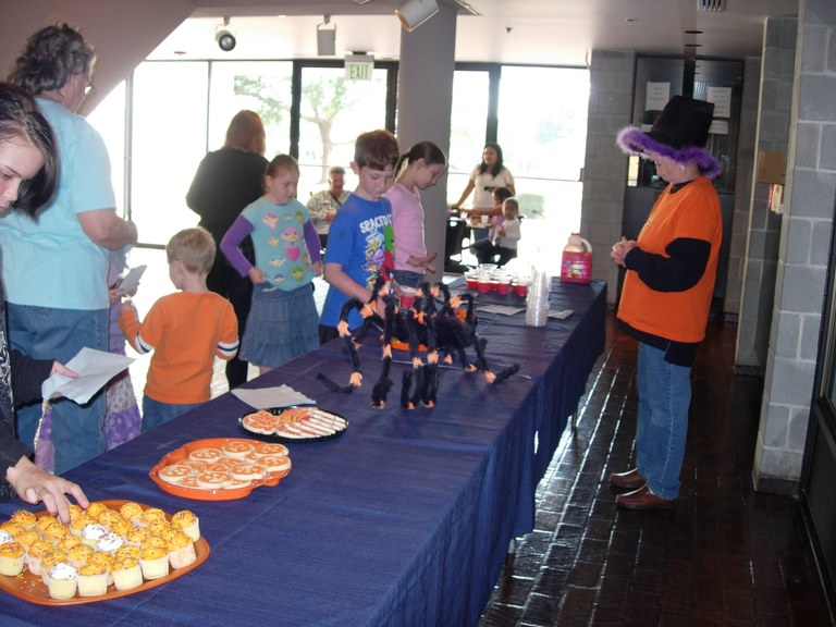 Kids grab Halloween Snacks