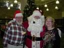 Santa with children's librarian, Sue Lintelman and volunteer, Al Brandli